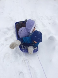 Me and Jacob sledding.  Down the sidewalk.